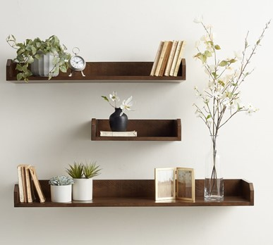 Floating shelves can spruce up your Edmund apartment and add storage space.